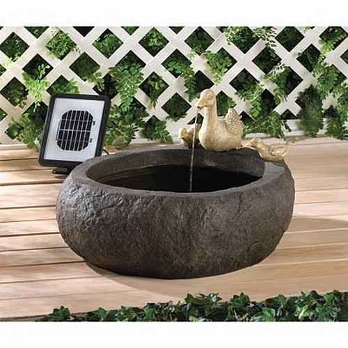 solar fountain with ducks